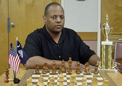 Keith Eubanks posing with the 2004 State Champion trophy. He shared the top honors with John Curcuru. Photo from scchess.org.