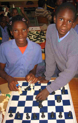 Two students in Otjituuo, Namibia graciously receive their new chess sets from North Carolina, USA.