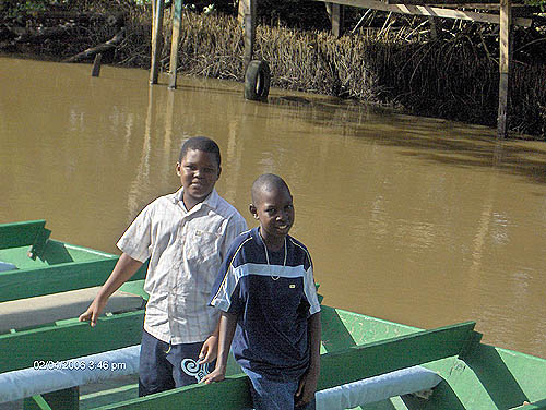 Jahzain and Keno on boat ride.. Copyright © 2006, Lesley-ann Nelson.