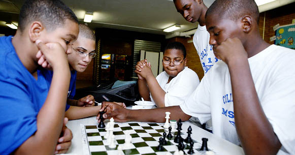 MS 118 students play a game of chess during the after-school programs called College Town, now in its fourth year. Photo by Enid Alvarez.