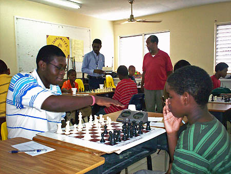 "Elton Joseph (left) trots out the ""Parham Attack"" against an opponent. Photo by Bahamas Chess Federation."