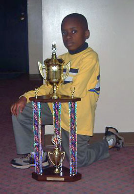 "Joshua ""Joshu-Kid"" Colas poses with his handsome trophy from the New York State Scholastic Championship. Photo courtesy of Guy Colas."