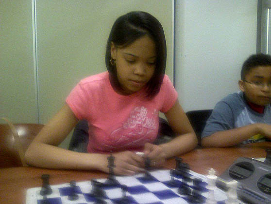 Medina Mathis, a junior at Cass Tech High School at a Detroit Chess Club blitzing.  Photo by Kevin Fite.