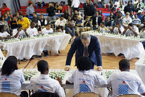 Kasparov at Harlem simultaneous exhibition. Photo by Harlem Children's Zone.