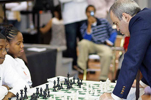 Kasparov squaring off against Medina Parrilla, U.S. Girl's Champion. Photo by Harlem Children's Zone.