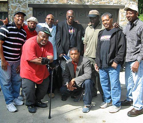L-R: Nigel Mitchell, Larry Saxby, Lamont 'Malik' Rogers, Glenn Bady, Robert Gist, Bruce Thompson Jonathan Phillips, Ray 'Dragon' Robinson (front) and Akeem Thompson (kneeling)