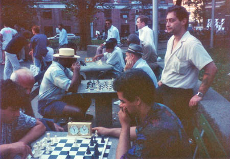 Russian Paul waiting for a game while Ernest Colding (seated right) is in a test.