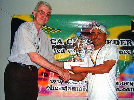 Shane Matthews (r) accepts the winners trophy from Robert Wheeler.