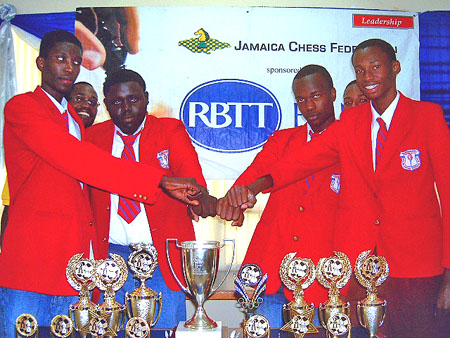 Camperdown: (L-R) Peter Thomas (Capt.), Warren Cornwall, Damion Davy and Rayon Walters touch fists in celebration. Coach National Master Equitable Brown (background left) and reserve O'Shane Reid (backgrond right).