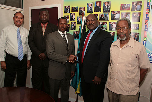From left to right Mr. Archie Nairn, Permanent Secretary of Ministry of Youth and Sports; Mr. Milton Evans, Vice President of The Bahamas Chess Federation (BCF); Hon. Desmond Bannister, Minister of Youth and Sports; Mr. Kean A. Smith, President of The BCF and Mr. Warren Seymour, BCF Tournament Director  and BCF Scholastic Chess Trainer.