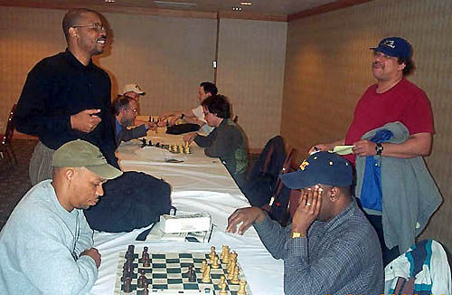 Tyrone Lee (standing right) chats with John Porter while Frank Johnson (seated left)blitzes with Kent Williams. Photo by Daaim Shabazz.