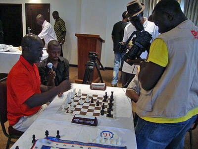 Francis Anquandah showing game to e.tv Ghana.