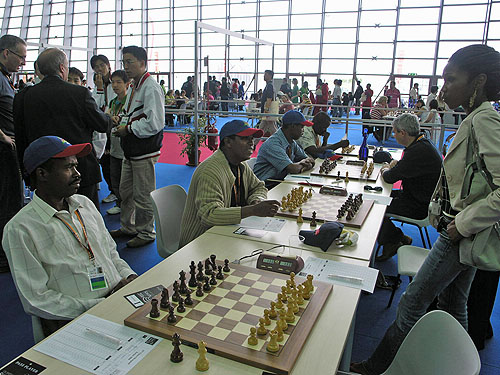 Haitians preparing to pawn off in round #1 of 2006 Olympiad in Turin, Italy.