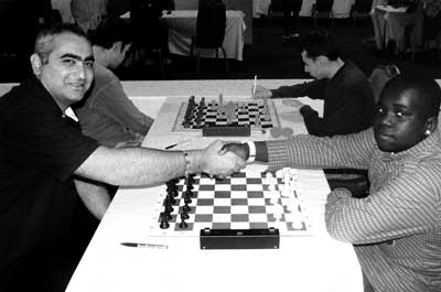 Giorgi Kacheishvili facing 12-year old Master Justus Williams in round one. Photo from uschess.org.