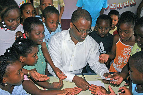Maurice Ashley signing autographs for Guadeloupean schoolkids.