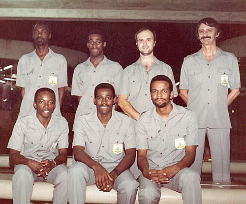 Barbados Airport Photo (1986) of the first Barbados Chess Olympiad squad. Back row, left to right: Othneil Harewood (First Reserve; also Board 3, 1998 Olympiad), David Dawson (board 4, 1986 & 1994 Olympiads), Andrew Chapman (Board 3), and manager Lindsay Bellhouse. Front row, left to right: Anthony Rolston (Second Reserve), Peter Dawson (Board 2, 1990 Olympiad), and yours truly (Board 1).