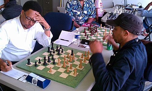 Frank Johnson playing Iyobebe Hanson at 64 Squares Chess Club.  Photos by Daaim Shabazz.
