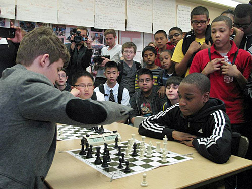 Carlsen attempts to hold off James Black, Jr. Photo by Elizabeth Spiegel.