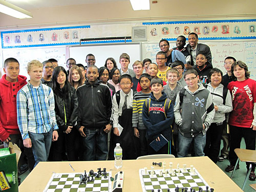 Magnus Carlsen (back) with National Champions, IS-318. Photo by Elizabeth Spiegel.