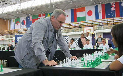 Garry Kasparov conducting a simultaneous exhibit in South Africa during a 2012 visit.