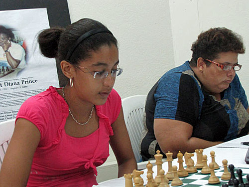 Camille Sauveur (Martinique) and Maria Thomas (Guyana) battle in their respective games.