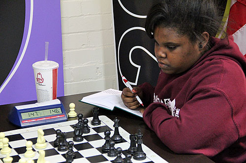 Jasmine Thomas playing at the St. Louis Chess Club in November.