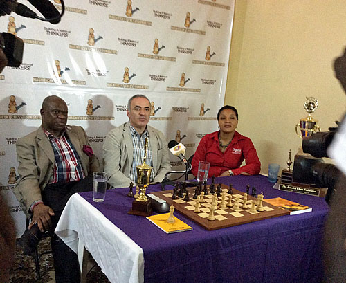 Ian Wilkinson with Garry Kasparov and Lisa Lewis Chairperson of DIGICEL Foundation, sponsor of the trip. Kasparov's entourage includes his personal assistant Mig Greengard and journalist Leontxo Garcia. - See more at: http://www.thechessdrum.net/blog/2014/04/05/kasparov2014-campaigns-in-jamaica/comment-page-1/#comment-22142