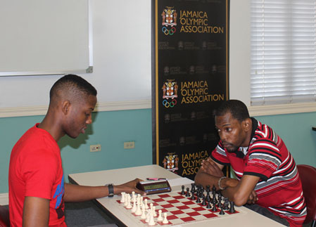 Nathan Hinds (L) about to face NM Daren Wisdom ® in their crucial final round clash in the 2015 Digicel President's Invitational Chess Tournament at the Jamaica Olympic Association.