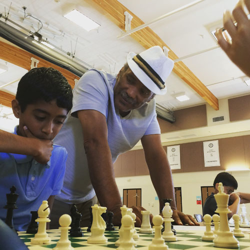 Emory Tate shares the joys of chess with his students at the  Chris Torres Chess Camp in Fremont, California. Photo by Chris Torres