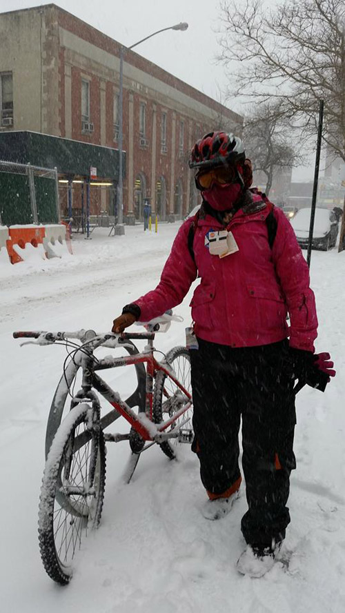 Adia Onyango cycling in snow.