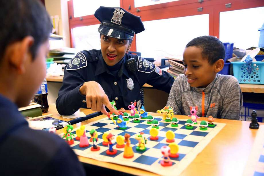 Officer Cookie has been teaching chess since 2006. Photo by Genna Martin.