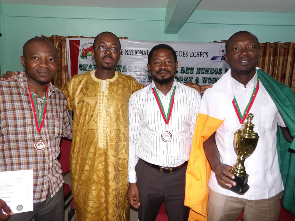 The Burkina Faso Chairman of the National Committee for Chess, Jean De Dieu Ouedraogo, (2nd from left) with winners at 4.4 Subzonal (from left to right), Geoffrey Adzua (Nigeria) – BRONZE medal, Yinka Adesina (Nigeria) – SILVER medal and Hermann Manan (Ivory Coast) – GOLD medal