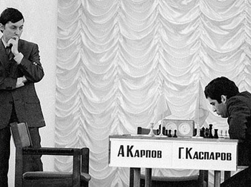 Anatoly Karpov hovers as Garry Kasparov ponders next move in 1984 match.