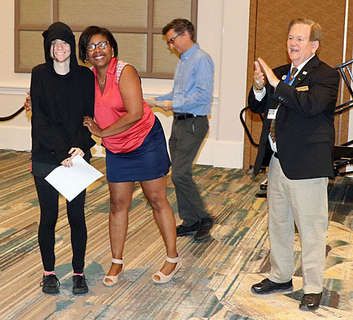 Robin Ramson presenting upset prize to Haring participant. David Guimand and Dewain Barber also pictured. Photo by Daaim Shabazz.
