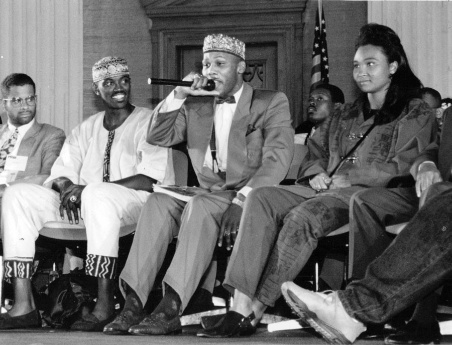 In September 1992, Craig Hodges (seated second from left) with rapper Prince Akeem (with microphone) and May May on Youth Empowerment Day at Operation PUSH headquarters. Photo by Sun-Times