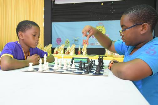 Young Jaheim Smart (right) from Lannaman's Preparatory won the speed chess playoffs to become Under 12 Champion. He played Corbin Harvey (left) from Harrison's Prep.