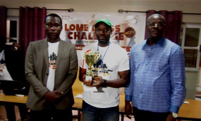 In happier times, Adu winning Lomé Chess Challenge. Commissioner Abalou Bodjona (left) and Togolese Vice President Abby Edah Ndjelle flank the Nigerian Eagle. Photo by Simeon Egbade.