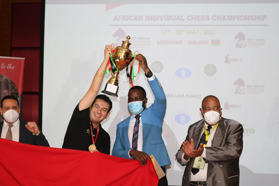 A victorious Ahmed Adly presented the championship trophy by Minister of Youth and Sport Ulemu Msungama with Egyptian Ambassador Maher Ely-Adawy (left) and President of African Chess Confederation Lewis Ncube (right).