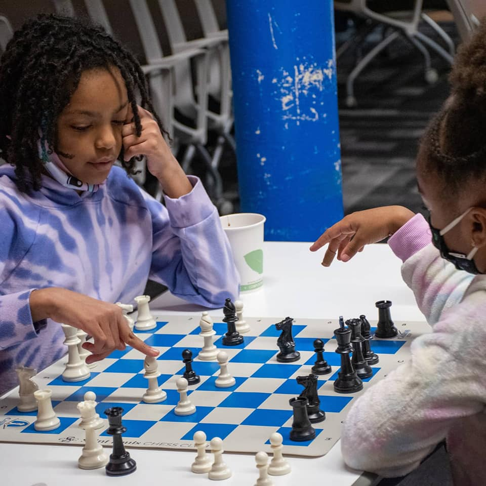Girls playing chess as part of 'Black Squares' initiative