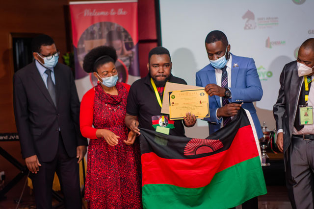A moment of pride for Malawians as Mwale received his well-deserved commendation. Namangale looks on.