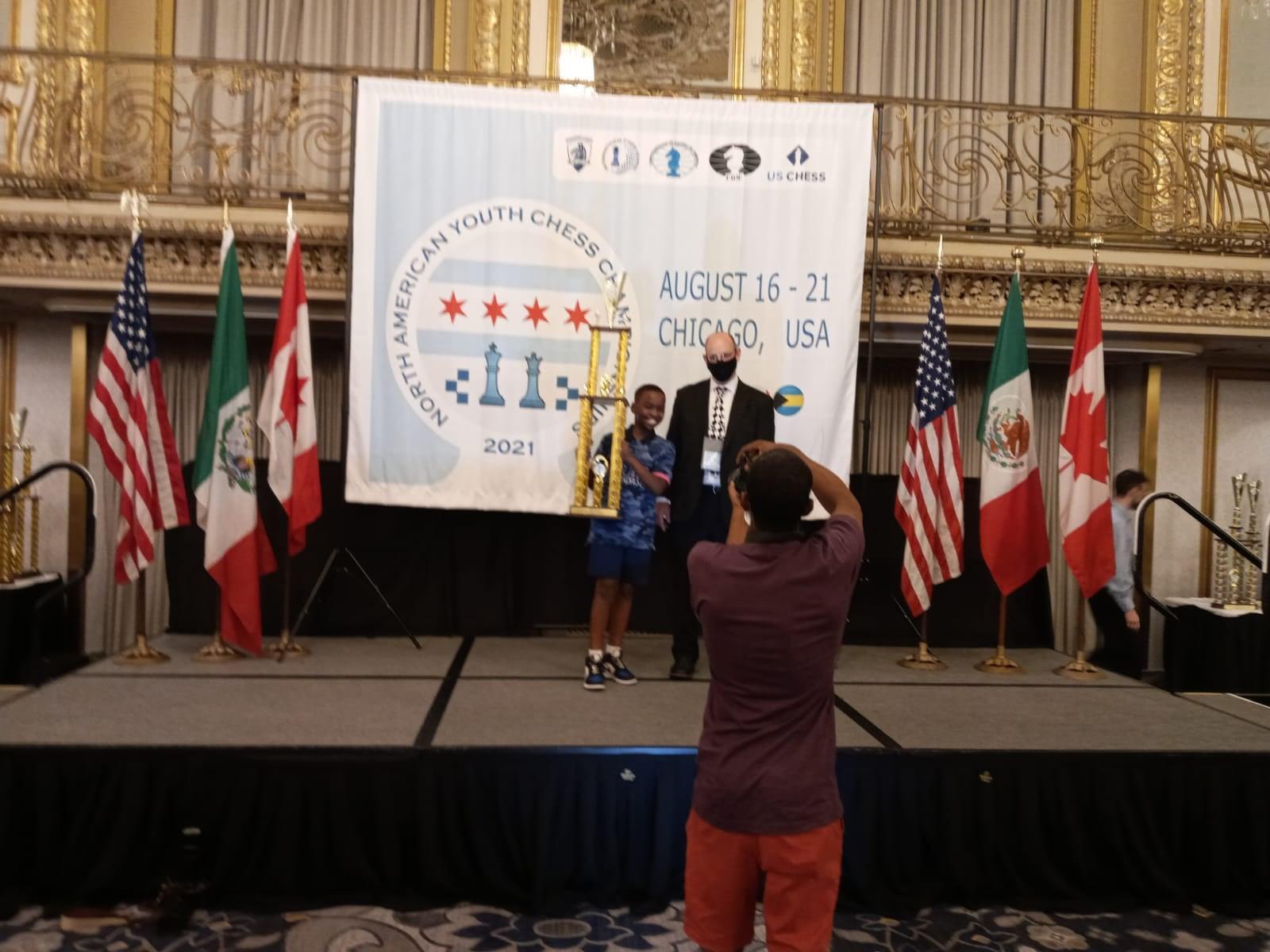 Tani Adewumi winning under-12 at North American Youth Chess Championships. Photo by Kayodo Adewumi