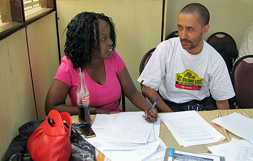 Our photographer Kim Bhari (right) here dissecting the action with Chess Kenya committee member Mary Kanyua.