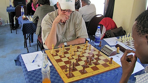 Peter Gilruth inflicting punishment on Akello.