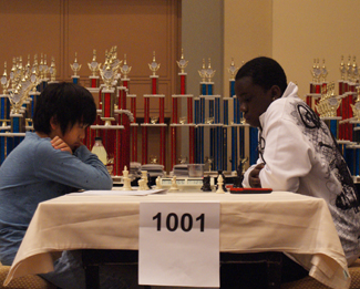 Benjamin Moon facing Justus Williams. Both scored 6/7 with two others, but Williams would go on to win on tiebreaks. Photo by Shaun Smith.