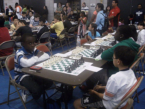 Joshua Colas about to pawn off against opponent. Photo by Guy Colas.