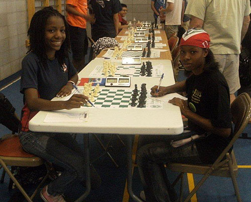 Darrian Robinson (USA) vs. Wislandie Desrosiers (Haiti). Photo by Guy Colas.