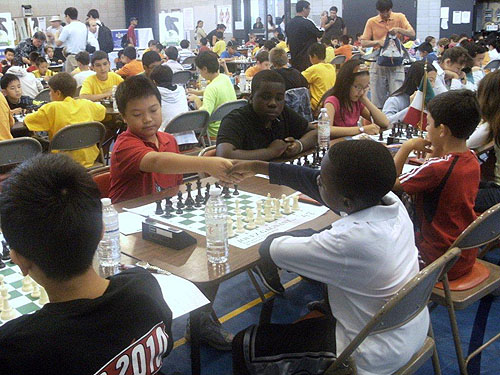 Michael Song (Canada) getting set to play Joshua Colas (USA). Justus Williams on top board against William Graig. Photo by Guy Colas.