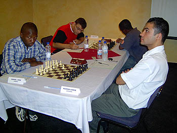 Daniel Jere facing off against IM Aimen Rizouk at the 2005 African Individual Chess Championships.