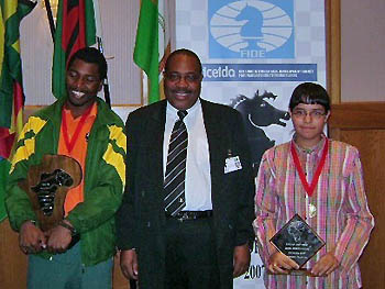 IM Robert Gwaze and WIM Mona Khaled are crowned as the new African Championships. FIDE Vice-President Lewis Ncube offers official congratulations.Copyright © 2007 Namibian Chess Federation.