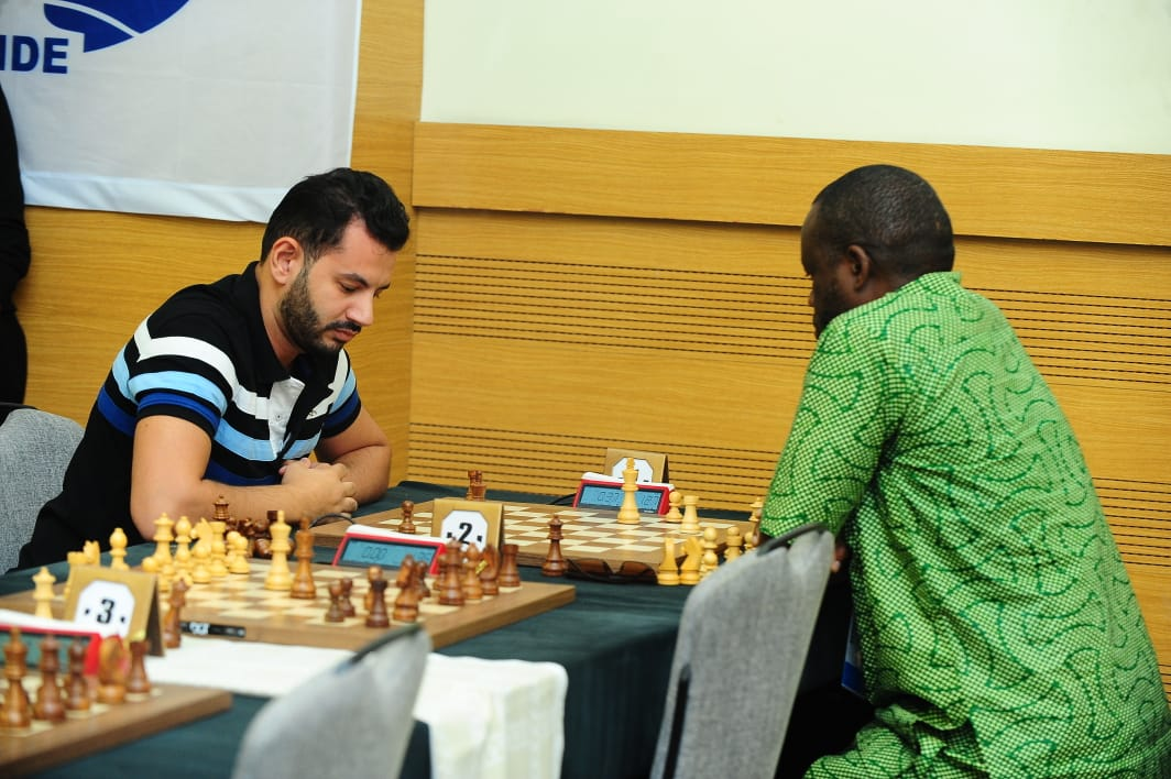 Tournament of Streaks: Ahmed Adly battling Oladapo Adu. Adly would lose this game, but later win five in a row to clinch the silver. Adu was 3/3, but lost his next three games falling off the medal pace. Photo by Mohamed Bounaji